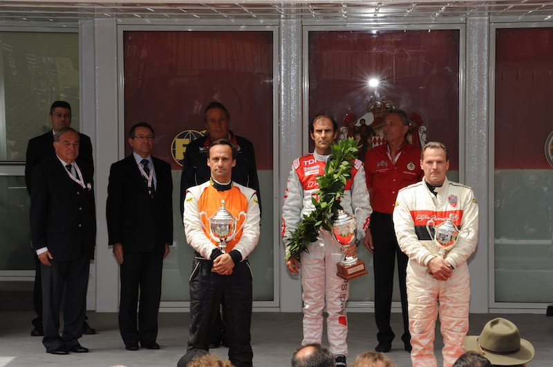 Emanuele Pirro atop podium for Formula 3 race