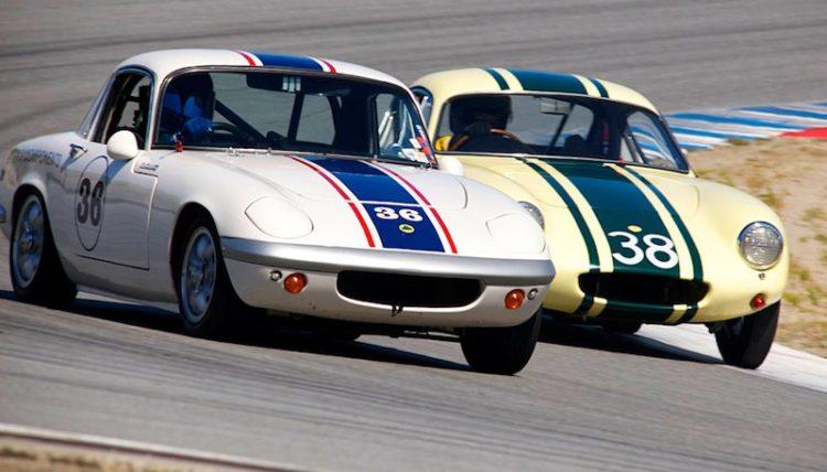 Michael Avila's Lotus Elan passes Henry Moore's 1962 Lotus Elite in turn five.