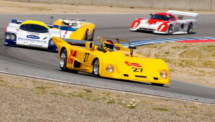 Keith Frieser 's 1972 Lola T290 leads a pack of big iron through five.