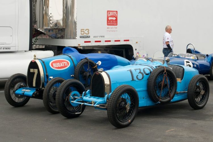 Bugattis and a Scarab in the pits.