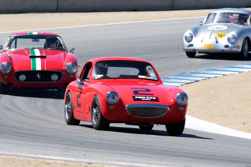Terrance Cowan's 1960 Austin-Healey Sprite Sebring leads a Ferrari 250 SWB and a Porsche 356.