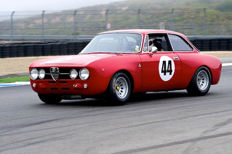 Steven Cole's 1968 Alfa Romeo GT AM onto the front straight.