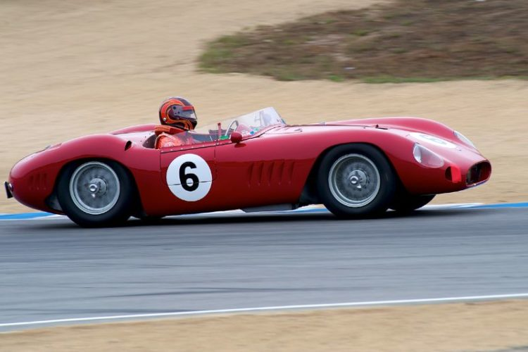 Jon Shirley accelerates out of five in his 1957 Maserati 300S.