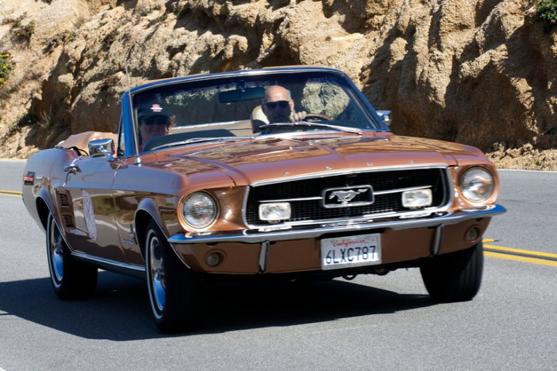 Benjamin Gage in his 1967 Ford Mustang GT Convertible.
