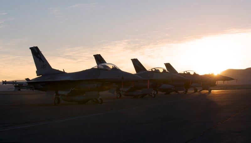 Pre dawn F-16s on the flight line.