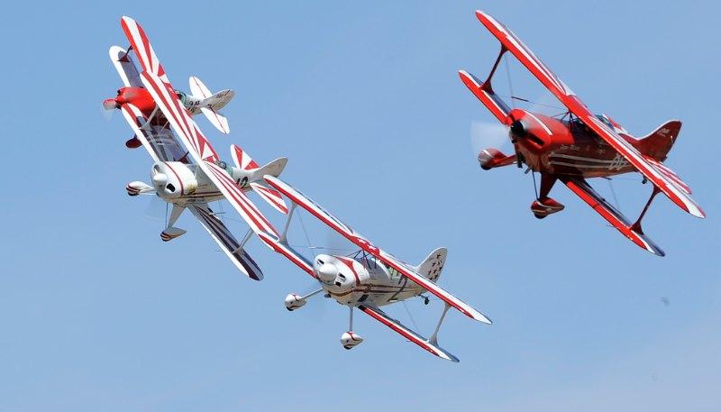 Biplanes. Four in close.