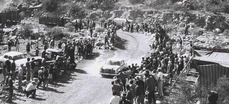 The Argentine Touring Car Grand Prix, 28 October to 7 November 1964: one-two-three victory for Mercedes-Benz. The perilous fords, known as vados, were popular places for spectators to gather. The water sprayed high in the air as Eugen Böhringer and Klaus Kaiser, the eventual winning team, drove through one in a Mercedes-Benz 300 SE (W 112).