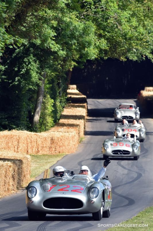 Sir Stirling Moss leads the selection of 300 SLRs down the Goodwood hill climb