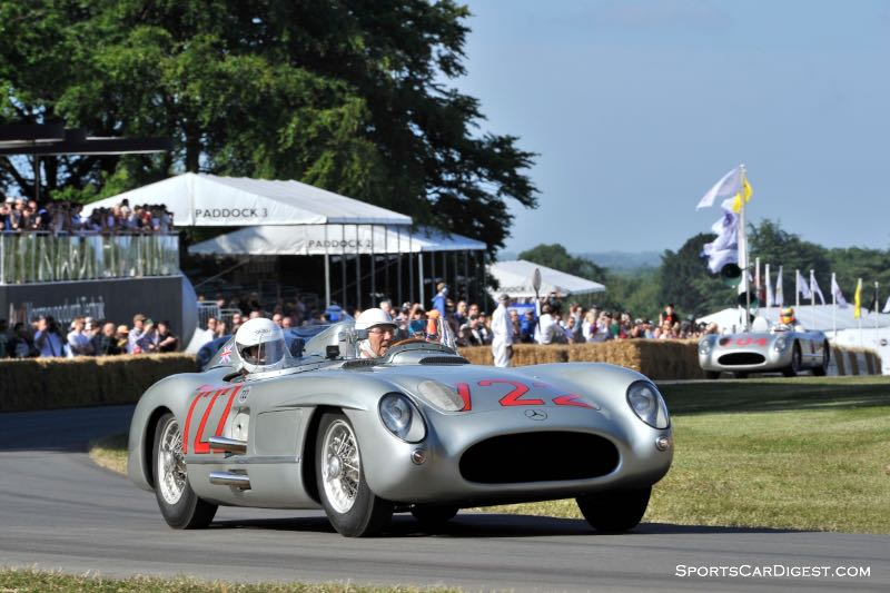 Sir Stirling Moss in the #722 Mercedes-Benz 300 SLR that he drove to victory at the Mille Miglia in 1955