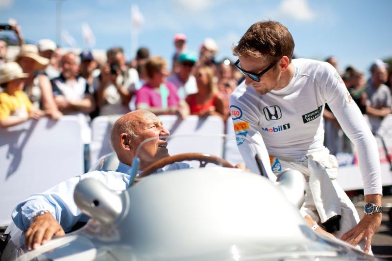 Sir Stirling Moss and Jenson Button share a moment during the Goodwood Festival of Speed 2015
