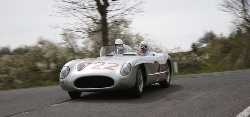 Sir Stirling Moss at the wheel of the Mercedes-Benz 300 SLR with starting number 722