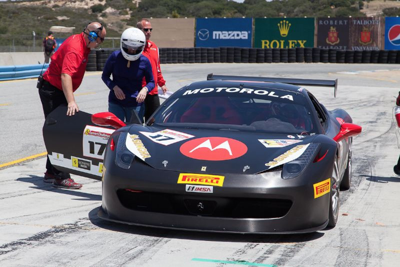 VIPs getting a taste of speed in one of the Ferrari 458 EVO