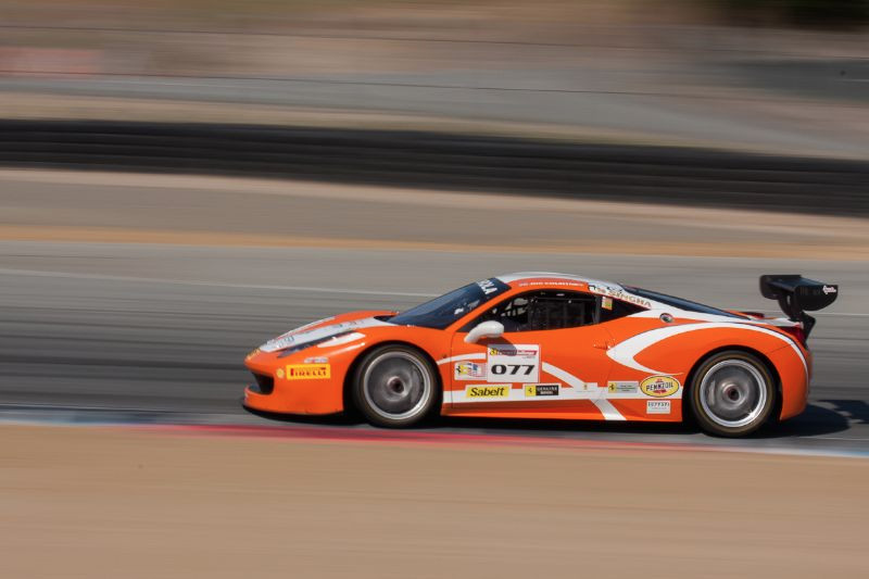 Joe Courtney races through the turn 5 apex in his #077 Ferrari 458 EVO