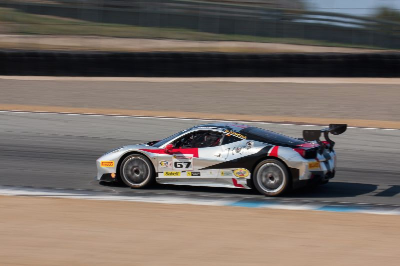 John Horejsi races his #67 Ferrari 458 EVO out of turn 5