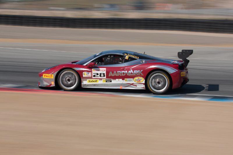 Jon Becker is on the apex of turn 5 in his #28 Ferrari 458 EVO