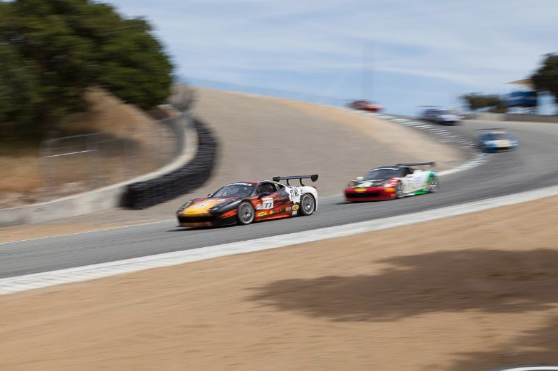 Harry Cheung leads the pack down the Corkscrew in his #77 Ferrari 458 EVO
