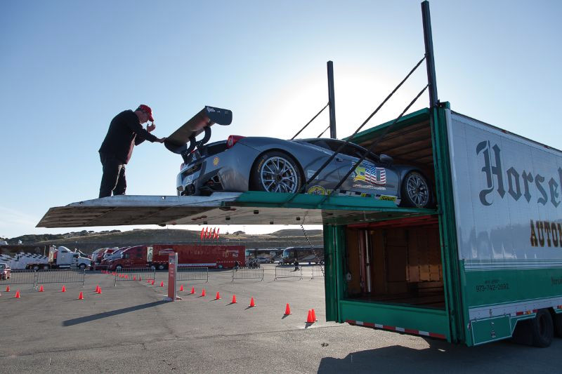 Early morning and cars are being unloaded at Laguna Seca