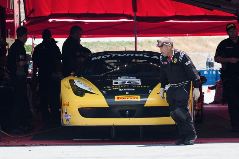 Busy, busy, busy. This Ferrari of San Francisco crew member hustles around the team's 458 EVO