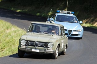 Paddock and course marshalling is done by historic polizia and carabinieri teams in Alfa Romeos including this Giulia a la The Italian Job and a 156.