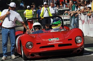 Talented lady driver Emmanuella Ricci at the startline in her 1967 Bizzarrini Spider, with her anxious nephew in the passenger seat.