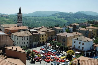 The cars park in the Vernasca town square while the drivers have lunch in a hilltop courtyard.