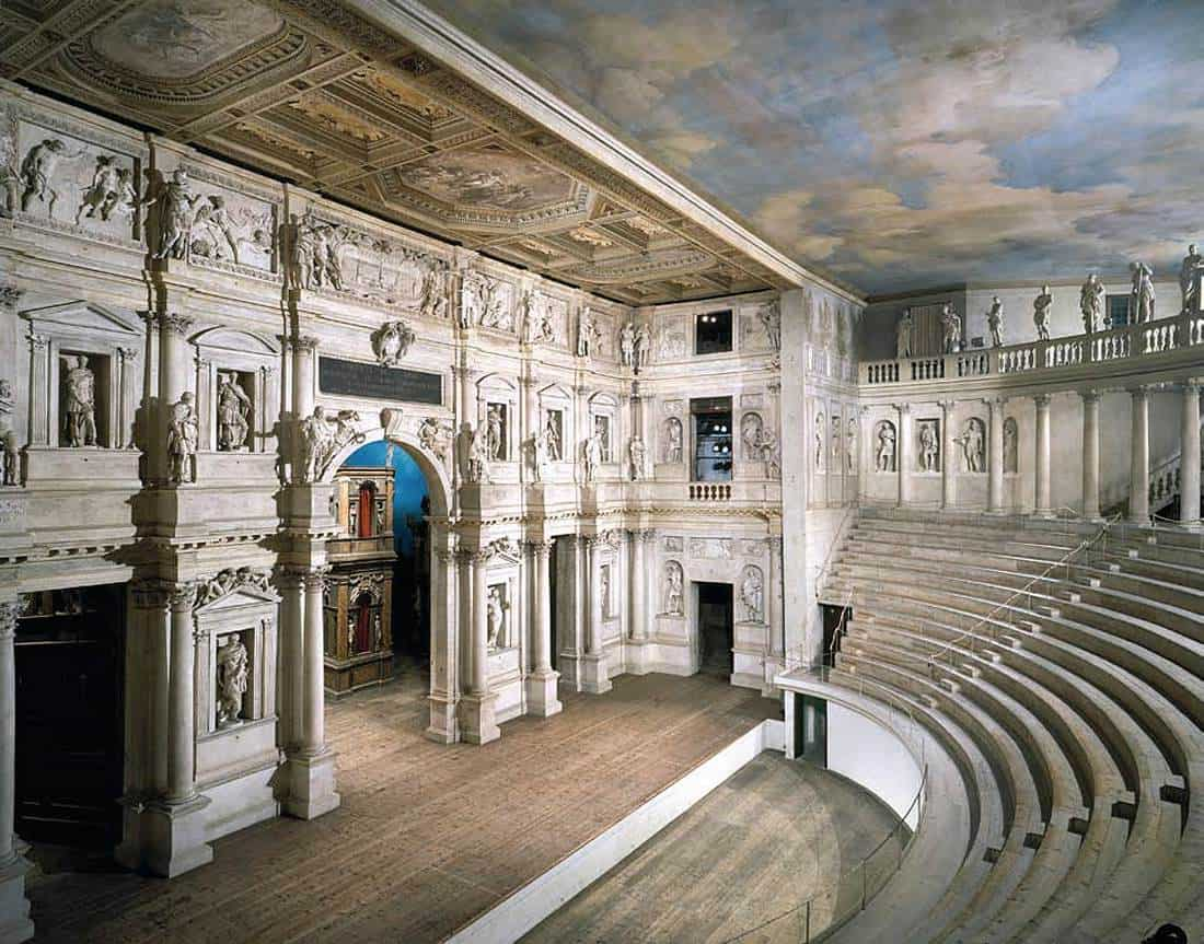 The initial concept for this design is rooted in the Teatro Olimpico in Northern Italy. We created a single, neutral facade on stage that surrounds all of the action in the show. The 1585 version is elaborately decorated with sculpture and paint. Ours was much more smooth and stark, and was painted digitally with light.