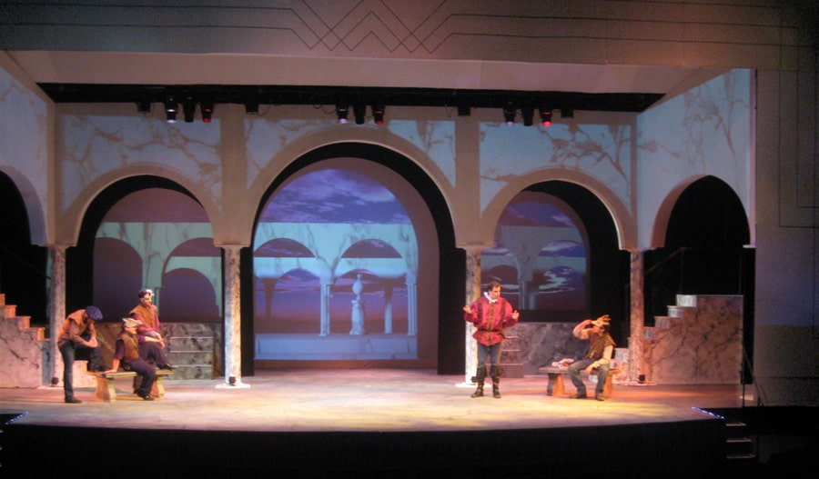 The space was framed with a false proscenium decorated with Deko-Renaissance crossover treatment. This design tied in directly to existing lines in the venue itself, Hanaway Theatre.
