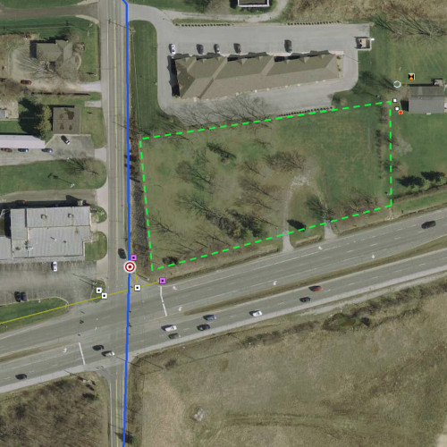 1.67+/- acre empty lot located on the corner of Homestead Rd. & US Highway 24 W