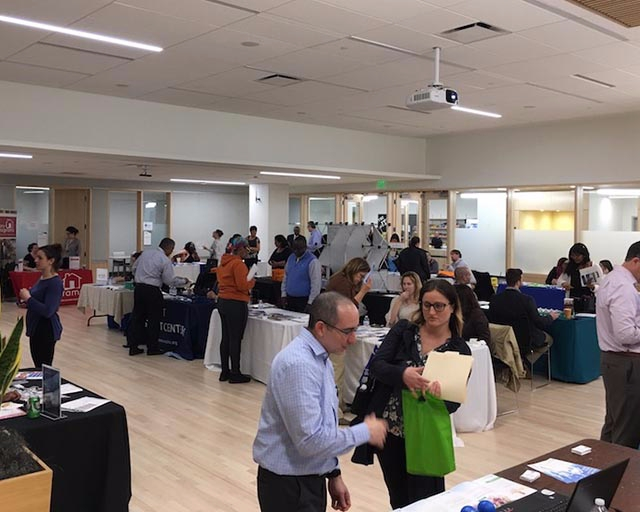 Students network with prospective employers