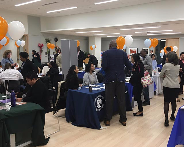 Students network with prospective employers during a career fair