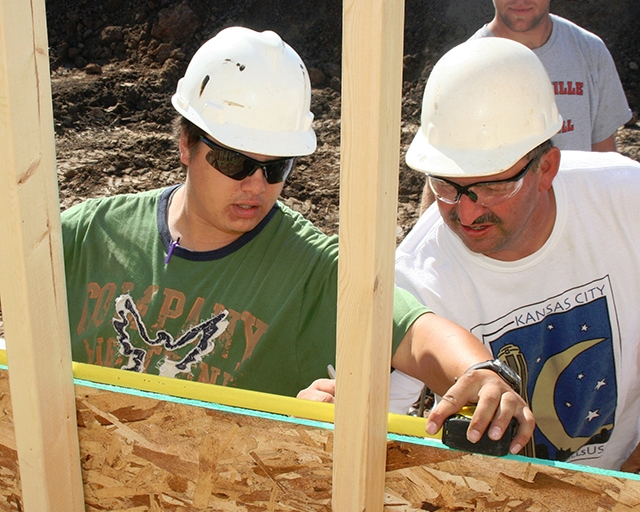 Construction Science students work on a home for the community.