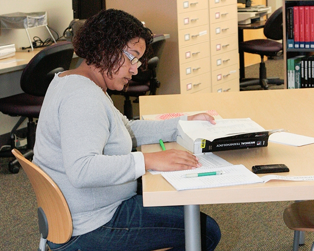 Students and the public utilize the resources of the campus library.