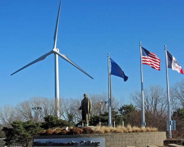 Kirkwood's entrance: a statue, 3 flags, and the windmill are visible