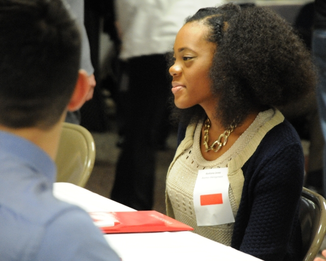 A student meeting potential employers at the Internship Meet and Greet.