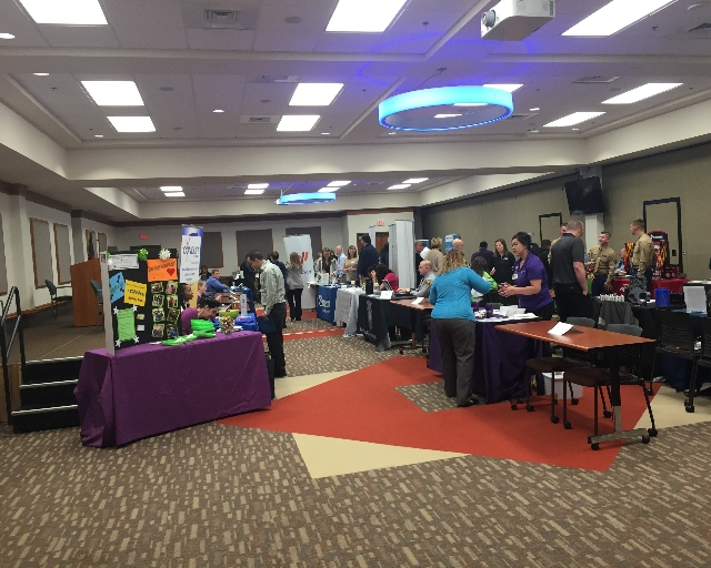 Tables with employers and students at a job fair
