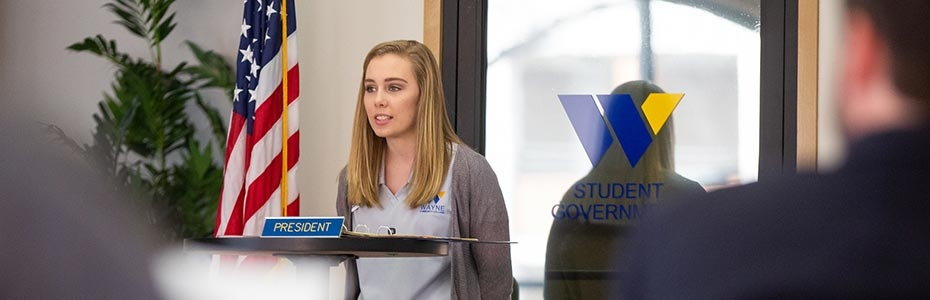 Student Government Association President addressing students.