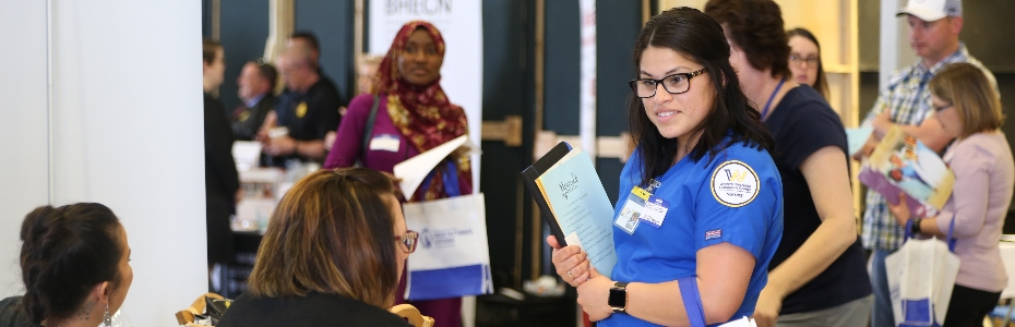 Nursing Student Visiting With Employer at Job Fair
