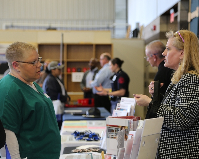 Student Visiting with Employer at Fair
