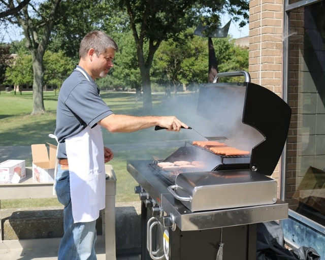 Marion Tech president Ryan McCall, manning the grill for staff picnic