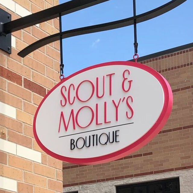 Scout & Molly's sign hanging in front of store