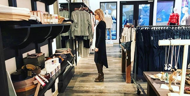 Woman browsing designer brands at Scout and Molly's North Bethesda