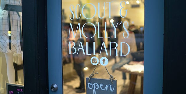 Front door of Scout and Molly's of Ballard with a calligraphy open sign