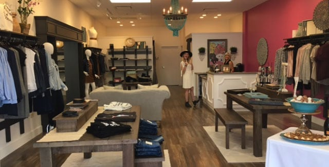 Woman browsing new styles at Scout and Molly's Loveland