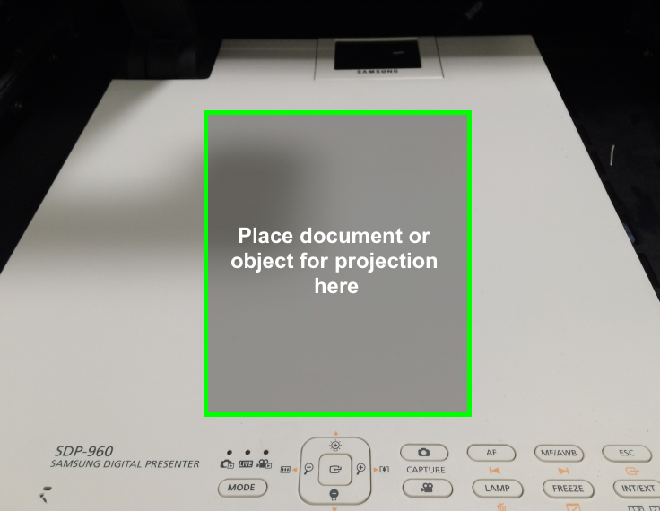 Place document or object onto the flat surface facing the projection lense