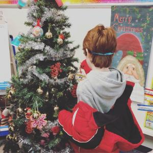 Sensory Student Decorating the Tree