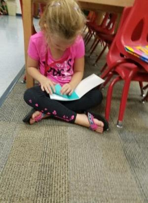 Abbie is showing us how to read to self.