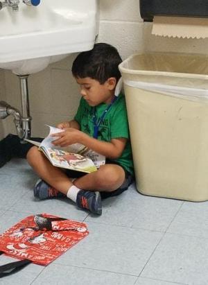 Andrew is reading in his quiet area!