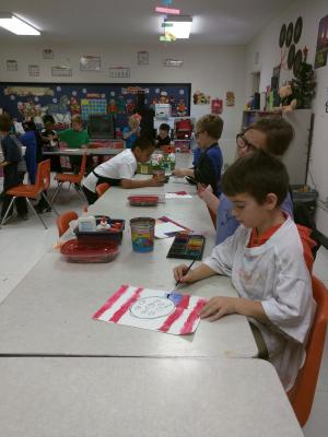 Mrs Stout's 1st grade class painting still lives