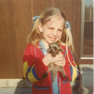 This is me as a child with a baby raccoon.  I have always loved animals.