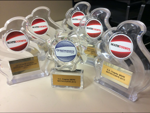 Awards from several years of SJHS MATHCOUNTS success